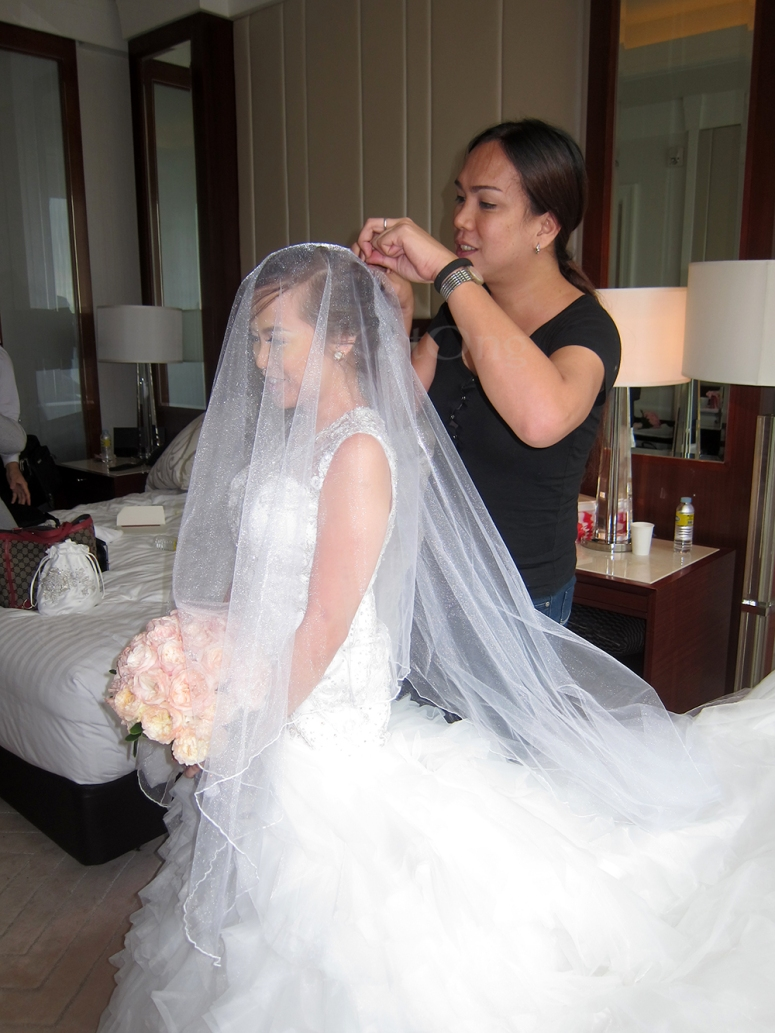 Wheng putting the veil on the bride!